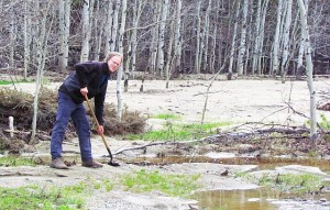 shovelling sand from the flood deposits beside the McClinchy River